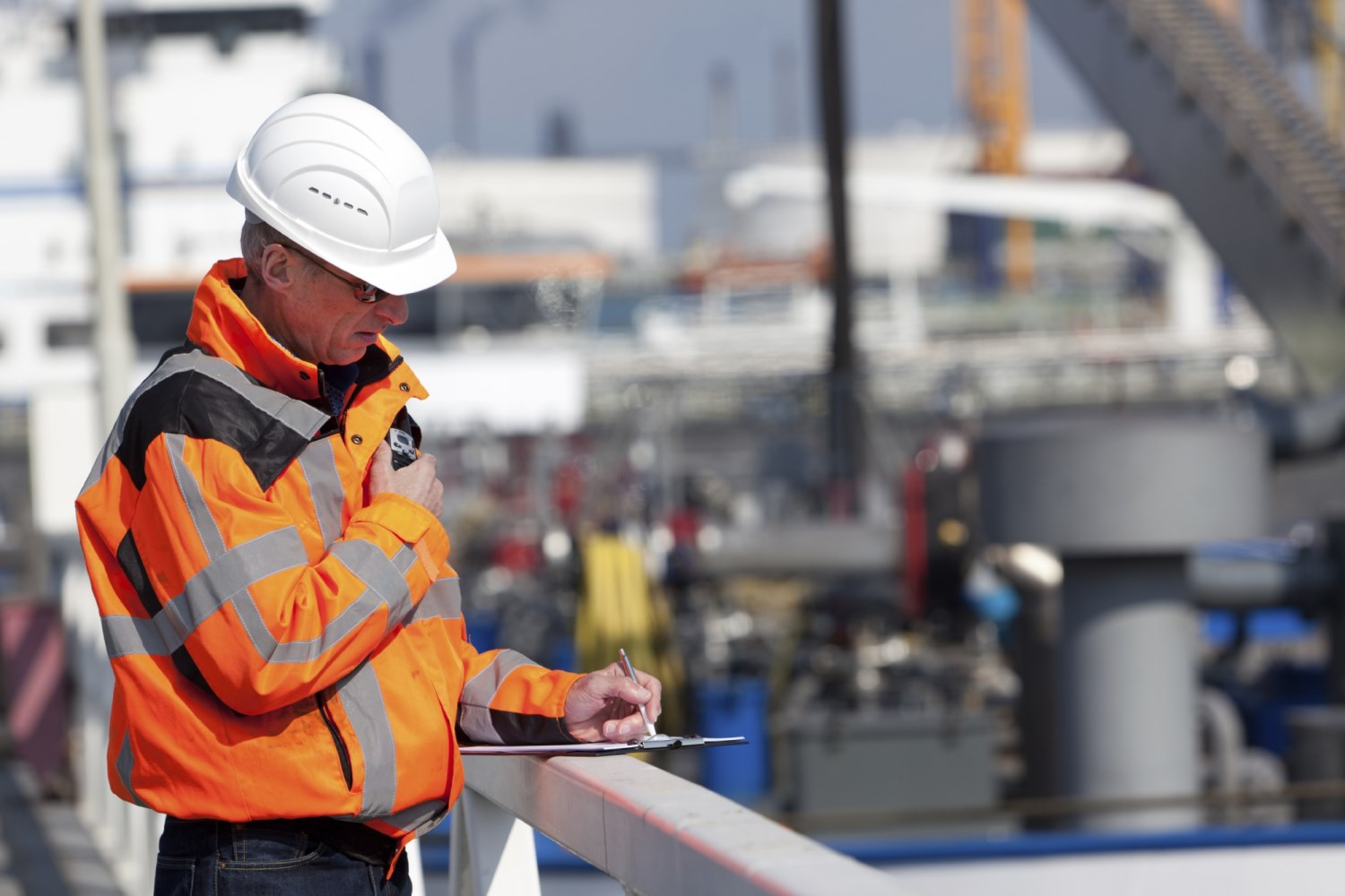 Dockworker giving instructions and writing  [url=http://www.istockphoto.com/file_search.php?action=file&userID=1153464&text=model61] Please click for more of this model[/url]     [url=http://www.istockphoto.com/file_search.php?action=file&userID=1153464&text=scene72] Please click for more of this series[/url] [url=http://www.istockphoto.com/file_search.php?action=file&userID=1153464&text=industry] Please click for more industry[/url]